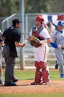 Umpire Mike Savakinas shakes hands with Indiana Hoosiers catcher Ryan Fineman (29) during a game against the Seton Hall Pirates on March 5, 2016 at North Charlotte Regional Park in Port Charlotte, Florida.  Seton Hall defeated Indiana 6-4.  (Mike Janes/Four Seam Images)