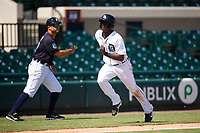 Detroit Tigers Daz Cameron (38) scores a run as manager Mike Rabelo waves him in during an Instructional League game against the Toronto Blue Jays on October 12, 2017 at Joker Marchant Stadium in Lakeland, Florida.  (Mike Janes/Four Seam Images)