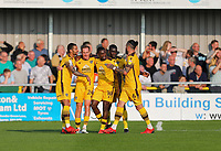 9th October 2021;  VBS Community Stadium, Sutton, London; EFL League 2 football, Sutton United versus Port Vale; Sutton United players celebrate equalising for 2-2 from an own goal by Garrity of Vale
