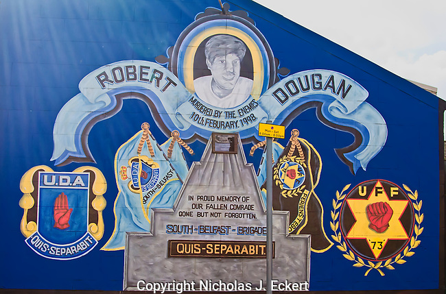 """Both the Loyalists and Republicans put up memorials to individual paramiitaries or teams of them who """"had something significant happen to them.""""  In Robert Dougan's case, he was killed by members of the Provisional IRA because he was viewed as a leading member of the UDA and involved in its own campaign of sectarian killings and other such nastiness.  The Provos never acknowledged responsibility for killing him but unlike in other cases, they never denied it either...""""Quis Separabit"""" means in Latin, """"Who will separate us"""" and is the motto of the Ulster Defence Association."""
