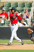Tim Anderson (2) of the Kannapolis Intimidators follows through on his swing against the Hickory Crawdads at CMC-Northeast Stadium on July 28, 2013 in Kannapolis, North Carolina.  The Crawdads defeated the Intimidators 6-1.  (Brian Westerholt/Four Seam Images)