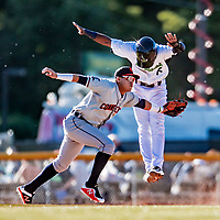 19 June 2018: Connecticut Tigers infielder Keyder Aristigueta gets Vermont Lake Monsters infielder Marcos Brito out at third in the first inning at Centennial Field in Burlington, Vermont. The Lake Monsters defeated the Tigers 5-4 in the rain-postponed conclusion of the Lake Monsters Opening Day game started June 18. Mandatory Credit: Ed Wolfstein Photo *** RAW (NEF) Image File Available ***