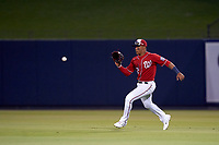 Washington Nationals outfielder Juan Soto (22) fields a ball during a Major League Spring Training game against the Miami Marlins on March 20, 2021 at FITTEAM Ballpark of the Palm Beaches in Palm Beach, Florida.  (Mike Janes/Four Seam Images)