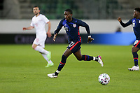 ST. GALLEN, SWITZERLAND - MAY 30: Timothy Weah #21 of the United States dribbles with the ball during a game between Switzerland and USMNT at Kybunpark on May 30, 2021 in St. Gallen, Switzerland.