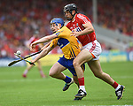 Podge Collins of Clare in action against Christopher Joyce of Cork during their Munster senior hurling final at Thurles. Photograph by John Kelly.