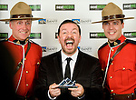BANFF, AB, CANADA - JUNE 15:  Actor Ricky Gervais, middle, shows uff his Peter Ustinov Comedy Award at the 2010 Banff World Television awards on June 15, 2010 at the Banff Springs Hotel in Banff, Alberta, Canada. Photo by Jimmy Jeong *** Local Caption *** Ricky Gervais