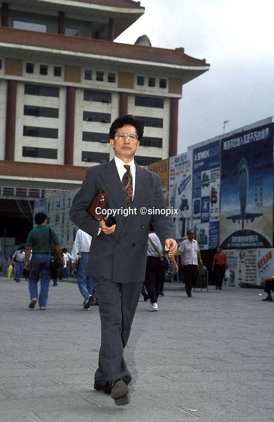 A Hong Kong businessman crosses the border into Shenzhen.