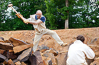 Workers at the Guedelon Castle, a medieval construction project in Treigny, France, on June 14, 2010.  <br /> <br /> The intent of the project, begun in 1997 by Michel Guyot, is to build a completely functioning 13th century medieval castle using only tools and techniques of that era.  Additionally all raw materials are taken from the surrounding countryside, which includes a quarry.  Over 40 people are employed by the project, as well as more than 100 volunteers.  The site has become the biggest tourist attraction in the French department of Yonne, with more than 200,000 people visiting annually.