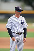 GCL Yankees East coach Justin Pope during a Gulf Coast League game against the GCL Phillies East on July 31, 2019 at Yankees Minor League Complex in Tampa, Florida.  GCL Phillies East defeated the GCL Yankees East 4-3 in the second game of a doubleheader.  (Mike Janes/Four Seam Images)