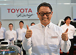 January 30, 2014, Tokyo, Japan - President Akio Toyoda of Japan's Toyota Motor Corp., flashes the thumbs-up sign during a presentation of its motor sports activities for 2014 in Tokyo on Thursday, January 30, 2014. They will include participation in the FIA World Endurance Championship and the Le Mans 24-hour race, the NASCAR racing series and the Super GT and Super Formula championships. Toyoda said its motor sports activities through Lexus Racing and Toyota Racing are aimed to bring more joy to more people through automobiles.  (Photo by Natsuki Sakai/AFLO)