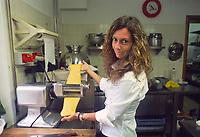 """- Italian food , typical kitchen of the Emilia region, restaurant """"Da Ivan"""" in Roccabianca (Parma), Barbara Aimi, wife of the owner, prepares pasta for tortelli (stuffed pasta).<br /> <br /> - Cibo italiano, cucina tipica della regione Emilia, ristorante """"Da Ivan"""" di Roccabianca (Parma), Barbara Aimi, moglie del titolare prepara la pasta per i tortelli"""