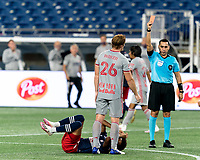 FOXBOROUGH, MA - AUGUST 29: Tim Parker #26 of New York Red Bulls receives a straight red card during a game between New York Red Bulls and New England Revolution at Gillette Stadium on August 29, 2020 in Foxborough, Massachusetts.