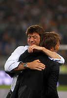 Calcio, Supercoppa di Lega: Juventus vs Lazio. Roma, stadio Olimpico, 18 agosto 2013.<br /> Juventus president Andrea Agnelli, and coach Antonio Conte, right, celebrate at the end of the Italian League Supercup football final match between Juventus and Lazio, at Rome's Olympic stadium,  18 August 2013. Juventus won 4-0.<br /> UPDATE IMAGES PRESS/Isabella Bonotto