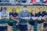 Michigan Wolverines non roster players Keaton Carratini, Jordon Rogers, Danny Zimmerman, Jack Van Remortel and Dillon Nowicki in the dugout before playing against the Vanderbilt Commodores during Game 1 of the NCAA College World Series Finals on June 24, 2019 at TD Ameritrade Park in Omaha, Nebraska. Michigan defeated Vanderbilt 7-4. (Andrew Woolley/Four Seam Images)