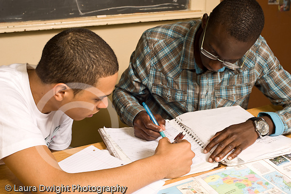 Education High School Mathematics class two male students conferring about work horizontal