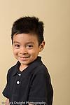 closeup headshot portrait of boy age 4 or 5 vertical