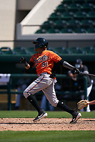 Baltimore Orioles Isaac De León (91) bats during a Minor League Spring Training game against the Detroit Tigers on April 14, 2021 at Joker Marchant Stadium in Lakeland, Florida.  (Mike Janes/Four Seam Images)