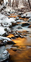 Golden reflection of the sun on a stream in a remote location of Little Cottonwood Canyon, Utah.