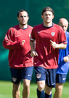 Landon Donovan, left and John O'Brien warm up before training in Hamburg, Germany, for the 2006 World Cup, June, 8, 2006.
