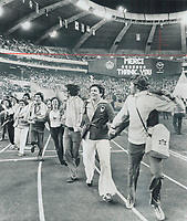 1976 FILE PHOTO - ARCHIVES -<br /> <br /> 1976 FILE - <br /> <br /> Canadian Athletes intermingle with athletes from around the world in what Star writer John Brehl described as an incredible spectacle that was cornball and lunatic and an immense mish-mash; and it was simply great - closing night at the Montreal Olympics. It was viewed by world television audience of an estimated billion people; and a sellout crowd of 75;000 in stadium. Some had paid scalpers up to $250 for a single ticket-and some said later it was worth it.<br /> <br /> PHOTO : Bull, Ron<br /> <br /> PHOTO : Ron BULL - Toronto Star Archives - AQP