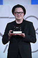 """Teemu Nikki poses with the Audience Award Armany Beauty for """"The Blind Man Who Did Not Want To See Titanic"""" during the Winners Red Carpet as part of the 78th Venice International Film Festival in Venice, Italy on September 11, 2021. <br /> CAP/MPI/IS/PAC<br /> ©PAP/IS/MPI/Capital Pictures"""