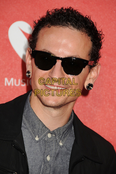 Chester Bennington, Linkin Park, Stone Temple Pilots. <br /> 9th Annual MusiCares MAP Fund Benefit Concert - Arrivals held at Club Nokia, Los Angeles, California, USA, 30th May 2013.<br /> portrait headshot earrings sunglasses grey gray shirt black <br /> CAP/ADM/BP<br /> ©Byron Purvis/AdMedia/Capital Pictures