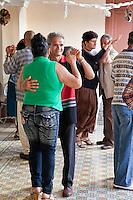 Cuba, Trinidad.  Couples Dancing in a Casa de la Cultura Recreation Center.