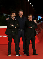 """From left, Open Arms founder Oscar Camps, director Marcel Barrena, and actor Eduard Fernandez pose on the 16th International Rome Film Fest (Festa del Cinema di Roma) red carpet for the movie of the film """"Mediterraneo: The Law of The Sea  """" on October 15, 2021 at the Auditorium Parco della Musica in Rome.<br /> UPDATE IMAGES PRESS/Isabella Bonotto"""