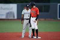 Ezequiel Duran (2) of the Hudson Valley Renegades looks at Hudson Haskin (26) of the Aberdeen IronBirds as he stands on second base at Leidos Field at Ripken Stadium on July 23, 2021, in Aberdeen, MD. (Brian Westerholt/Four Seam Images)