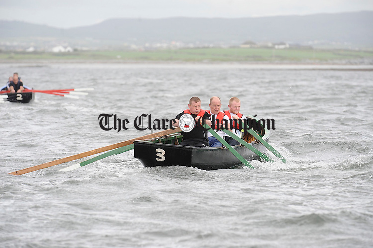 Tommy  Brien, Seanie Hayes and Eoin Honan of Doonbeg in action at the Leon Currach Regatta at Seafield, Quilty. Photograph by John Kelly.