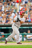 Alberto Callaspo (6) of the Los Angeles Angels follows through on his swing against the Detroit Tigers at Comerica Park on June 25, 2013 in Detroit, Michigan.  The Angels defeated the Tigers 14-8.  (Brian Westerholt/Four Seam Images)