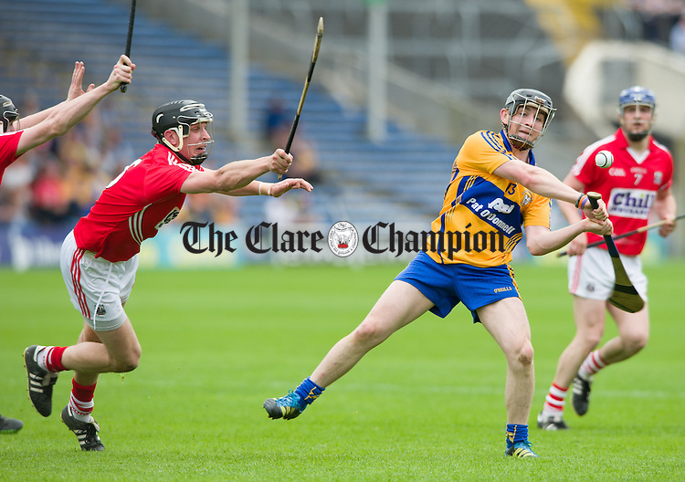 Mikey O Neill of Clare in action against Tadhg Healy of Cork during their Intermediate hurling game at Thurles. Photograph by John Kelly.