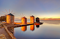 The sunrise at the famous windmills in Chios island, Greece