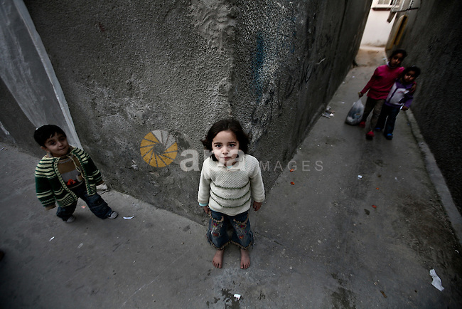 Palestinian children play in the streets of the Jabaliya refugee camp, northern Gaza Strip, 22 February 2012. The United Nations Relief and Works Agency (UNRWA) states that the Israeli blockade on Gaza has made life more difficult for the inhabitants of the camp. Unemployment levels have increased dramatically, with a large proportion of the residents relying on UNRWA's nutritional and financial assistance, it was reported. Photo by Ali Jadallah