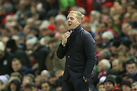 Swansea City Manager Garry Monk issues instructions as he stands in the technical area during the Barclays Premier League Match between Liverpool and Swansea City played at Anfield, Liverpool on 29th November 2015