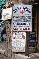 India, Rishikesh.  Yoga Lessons, Ayurvedic Medicine Advertisements.