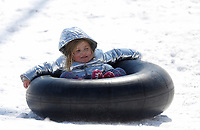 Rory Omohundro (cq), 4, uses an innertube Thursday, February 18, 2021, as she sleds down a hill at Kessler Mountain Regional Park in Fayetteville. The National Weather Service forecast for Friday is mostly sunny skies with a high near 37 degrees. Check out nwaonline.com/210219Daily/ and nwadg.com/photos for a photo gallery.<br /> (NWA Democrat-Gazette/David Gottschalk)