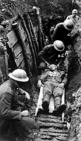 Marine receiving first aid before being sent to hospital in rear of trenches.  Toulon Sector, France.  March 22, 1918. Sgt. Leon H. Caverly, USMC. (Army)<br /> NARA FILE #:  111-SC-12151<br /> WAR & CONFLICT BOOK #:  666