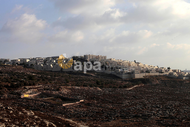 A general view shows the Ramot settlement, an urban settlement in an area Israel annexed to Jerusalem after capturing it in the 1967 Middle East war, August 25, 2013. Palestinian President Mahmoud Abbas last week reiterated his commitment to a two-state solution that would see the establishment of an independent Palestinian state on the pre-1967 lines with Jerusalem as its capital, accusing Israel of placing 'obstacles' on the way to the continuation of the peace talks by pursuing construction in settlements 'in a provocative manner.' He said that Israel's actions were in violation of sincere intentions to achieve peace and end occupation. Photo by Saeed Qaq