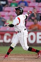 Salem-Keizer Volcanoes center fielder Jesus Galindo #6 bats against the Spokane Indians at Volcanoes Stadium on August 10, 2011 in Salem-Keizer,Oregon. Salem-Keizer defeated Spokane 7-6.(Larry Goren/Four Seam Images)