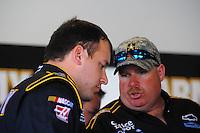 Feb 11, 2009; Daytona Beach, FL, USA; NASCAR Sprint Cup Series driver Ryan Newman (left) talks with crew chief Tony Gibson during practice for the Daytona 500 at Daytona International Speedway. Mandatory Credit: Mark J. Rebilas-