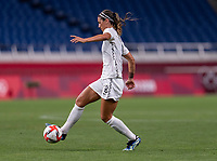 SAITAMA, JAPAN - JULY 24: Abby Erceg #8 of New Zealand dribbles during a game between New Zealand and USWNT at Saitama Stadium on July 24, 2021 in Saitama, Japan.
