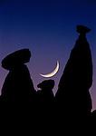Crescent moon sets over Fairy Chimneys, Cappadocia, Turkey.