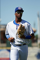 South Bend Cubs left fielder Eloy Jimenez (27) jogs to the dugout during the second game of a doubleheader against the Peoria Chiefs on July 25, 2016 at Four Winds Field in South Bend, Indiana.  South Bend defeated Peoria 9-2.  (Mike Janes/Four Seam Images)