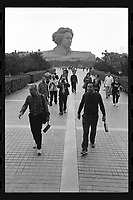 Elderly Chinese walk with their beverage bottles in front of the statue of a young Chairman Mao Zedong at the central city of Changsha, Hunan Province, China, October 2019. The enormous statue stands more than 100ft tall.