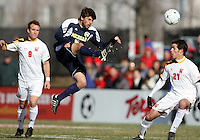 Adam Shaw #5 of the University Michigan sends the ball over the head of John Stertzer #27 during an NCAA quarter-final match against the University of Maryland at Ludwig Field, University of Maryland, College Park, Maryland on December 4 2010.Michigan won 3-2 AET.