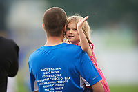 Young Batavia Muckdogs fan waves during the national anthem before a game against the West Virginia Black Bears on August 7, 2017 at Dwyer Stadium in Batavia, New York.  West Virginia defeated Batavia 6-3.  (Mike Janes/Four Seam Images)