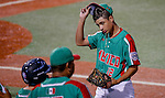 ABERDEEN, MD - AUGUST 04: David Guevara #12 of Mexico walks back to the dugout at the end of the 2nd inning where he gave up a home run to Puerto Rico in a semifinal game between Puerto Rico and Mexico during the Cal Ripken World Series at The Ripken Experience Powered by Under Armour on August 4, 2016 in Aberdeen, Maryland. (Photo by Ripken Baseball/Eclipse Sportswire/Getty Images)