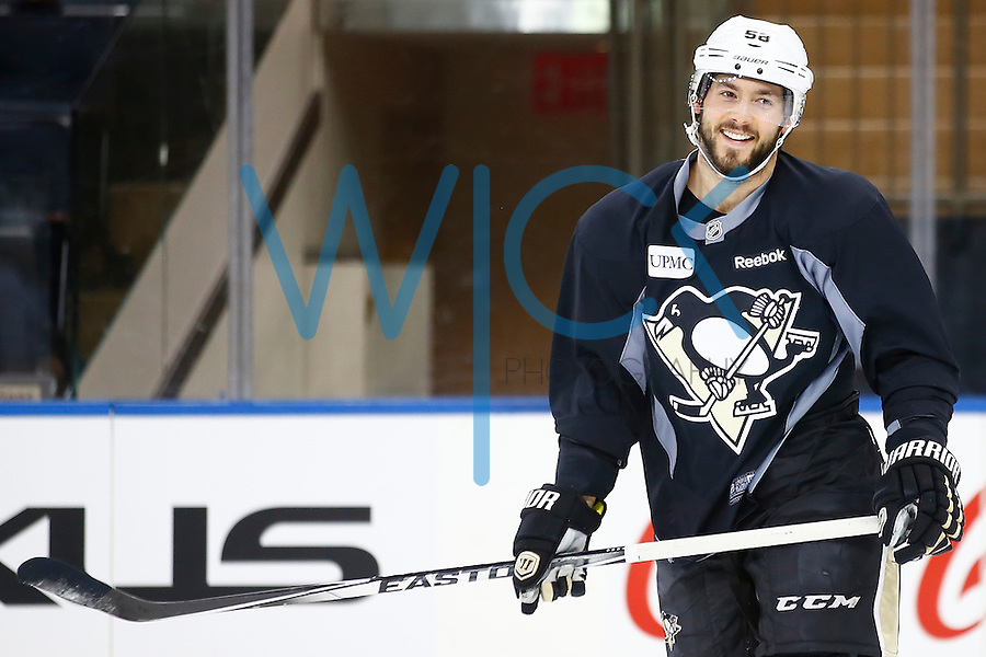 Kris Letang #58 of the Pittsburgh Penguins laughs during practice at Madison Square Garden in New York City on April 20, 2016. (Photo by Jared Wickerham / DKPS)