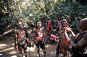 Lolgorian, Kenya. Eunoto coming of age ceremony; moran Maasai warriors collecting white clay mud for body paint.